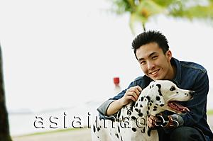 Asia Images Group - Man with Dalmatian dog, smiling at camera