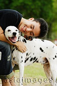 Asia Images Group - Man embracing dog