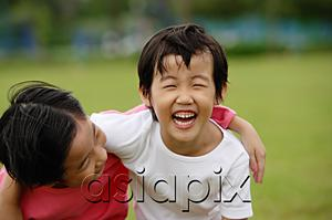 AsiaPix - Two girls with arms around each other, laughing